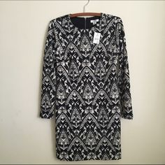 HP | Long Sleeve Dress; Black & White Pattern NWT. This is so cute on. Form fitting. Long sleeve. Silky underlay underneath. Zipper in back. Length 35 inches. Cato Dresses Long Sleeve