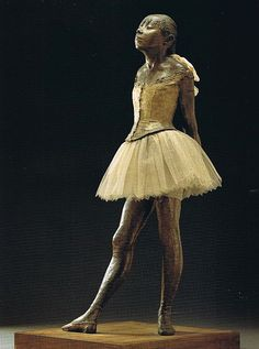 """La Petite Danseuse de Quatorze Ans"" (""Little Dancer of Fourteen Years""), c. 1881, is a sculpture by Edgar Degas of a young dance student named Marie van Goethem. The sculpture was originally made in wax before it was cast in 1922 in bronze"