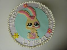 Littlest pet shop marble themed cake with butter cream frosting