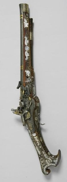 A pistol dating from circa 1600-1625 made of steel, silver, wood, mother-of-pearl; engraved, encrusted, gilded, silver-gilt in the Moscow Kremlin Armoury workshops by the master Pervusha (Pervoy) Isaev whose maker's mark in the form of a swan in a shield are featured on the lock plates. The lock-plates are engraved with floral ornament and a depiction of a subject popular in both Russian and made in the Russian Kremlin Armory Workshops, Moscow.