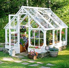 This greenhouse is made from the windows of an old dairy farm. Virtually all the materials are recycled, save for the galvanized screws that hold it all together. It provides the perfect greenhouse for budding annuals. Backyard Greenhouse, Small Greenhouse, Greenhouse Plans, Old Window Greenhouse, Greenhouse Film, Greenhouse Wedding, Cozy Backyard, Backyard Retreat, Underground Greenhouse