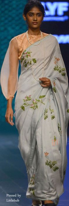 Sari on the runway - floral with a sheer puffed sleeve.