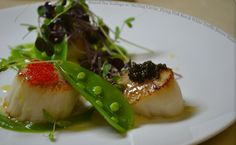 Seared Sea Scallops with sterling caviar, flying fish roe & white truffle beurre blanc