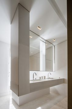 We love this floating sink in #bathroom. What do you guys think of all the white? www.remodelworks.com