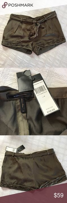 Silky olive green BCBG shorts Brand-new with tags. Size 4. Dusty Olive in color. 56% polyester 44% rayon. Extremely lightweight and perfect for the summer BCBGMaxAzria Shorts