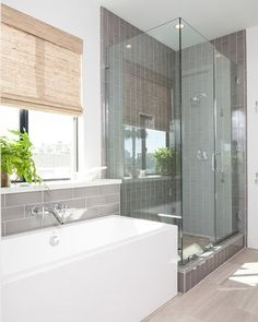 The master bathroom feature clean lines and beautiful tile work.