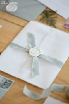 Neutral wedding invitation with Vellum and wax seal.