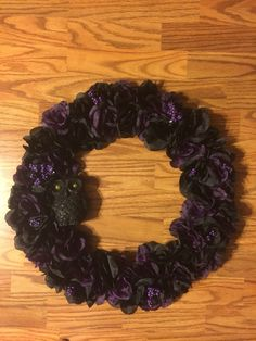 Halloween wreath with dollar tree black and purple roses with light up owl :)