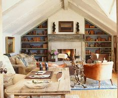 Love the color on these bookshelves.  Want to sit in this room and be cozy with a book