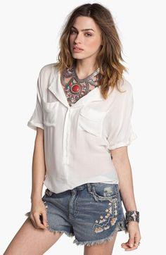 white shirt, denim cutoffs, statement necklace