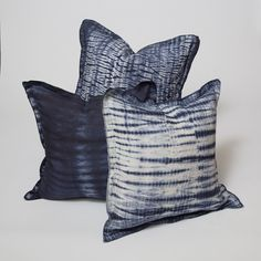 "Weighty yet supple linen is tie-dyed by hand to make these striking pillows. The linen is enzyme washed for softness, hand-tied in complicated patterns, and dipped in dye many times to achieve depth and variations in shades of indigo on a natural-colored background. Feather and down inserts included. Details Hand-dyed shibori patterning on linen. Inserts Included. Dimensions 24"" x 24"""
