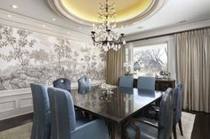 Morgante Wilson Architects installed a neutral de Gournay mural in this Dining Room which allows the dining chairs to be front and center.  The rock crystal chandelier coming from the lighted domed ceiling adds additional drama.
