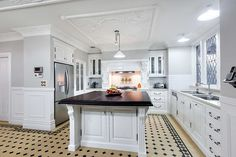 All white kitchen with feature benchtops, patterned tiled floor and feature ceiling. #kitchens #ceilings #floortiles