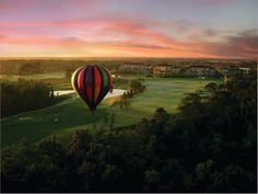 A hot air balloon over The Legends at Orange Lake Golf.