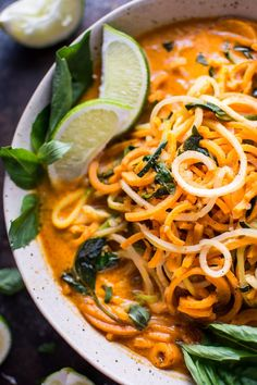 This vegan Thai lemongrass coconut curry soup is a light and fresh soup with spiralized sweet potato, zucchini, and celery root vegetable noodles.