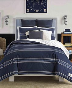 This handsome cotton comforter features crisp, clean horizontal stripes in sailcloth and is grounded against a deep navy background. Striped bedding sets that are subtle but still offer enough of a design to be deemed, striped bedding. #stripedbedding #bedding #beddingsets #afflnk