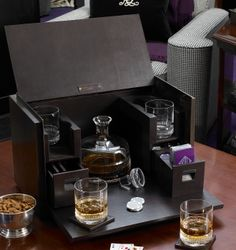 Limited-edition vice box in supple leather is ideal for entertaining, with included crystal decanter and four glasses, poker chips, signature cards and coordinating coasters