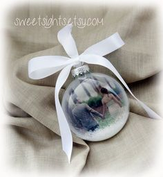 Check out this item in my Etsy shop https://www.etsy.com/listing/252933114/custom-photo-ornament-picture-christmas