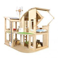 Just love this eco home dollhouse by PLAN TOYS...has recycling, windmills and even solar panels :)