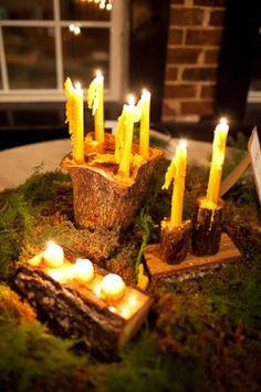 Moss, candles in wood wedding table centerpiec ideas. Perfect for Rustic or Irish wedding