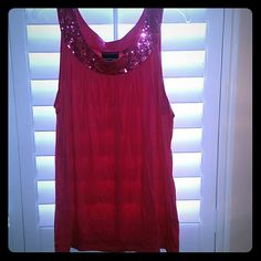 AVENUE PINK TANK WITH SEQUINED COLLAR Pink sparkly material or an iridescent pink sparkle. Hot pink color sequined collar. From the Avenue never been worn Avenue Tops Tank Tops