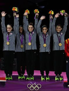 U.S. gymnasts Jordyn Wieber, Gabrielle Douglas, McKayla Maroney, Alexandra Raisman, Kyla Ross during the medal ceremony. Team USA won gold.