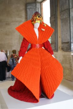 Haute Couture –Roberto Capucci Foundation Archives. Evening coat in orange and red pleated Casentino woolen cloth.