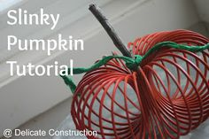 (I tried this but I didn't like how it turned out) Slinky Pumpkin -  Hot glue ends of the slinky together, spray paint orange, tie crepe paper vine onto stick, then stick into opening in the middle