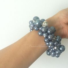 charcoal blue glass beaded bracelet is threaded mixed up with some clear faceted round beads and a rhinestone with elastic   detail as the pictures,