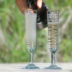 Swirl Champagne Glass with Ridges, $23, Artisans in a small factory hand blow each piece from recycled glass.