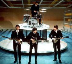 """In this Feb. 9, 1964, file photo, The Beatles, from left, Paul McCartney, George Harrison, Ringo Starr on drums, and John Lennon, perform on the CBS """"Ed Sullivan Show"""" in New York. The Beatles made their first appearance on """"The Ed Sullivan Show,"""" America's must-see weekly variety show, on Sunday, Feb. 9, 1964."""