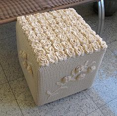 Obsessed with crochet ottoman covers.