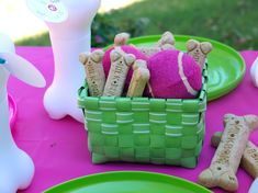 Dog themed centerpiece | The kids used frisbees as plates and drank from these cute bone straw ...