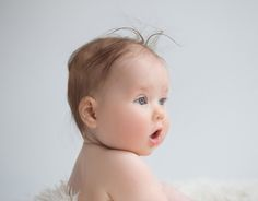 Baby Photos by Jo Frances Wellington, Award Winning Photographer - Baby with hair sticking up mouth pouting, by Jo Frances