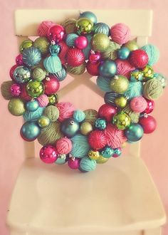 DIY wreaths - love this with yarn balls. Could do this for any season with different colors