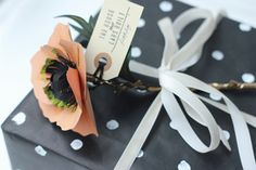 Paper flower gift toppers.