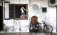[photo by Andre Paul Schultz] Life-like wall paintings by a local artist add a new dimension to the streets of George Town, Penang, Malaysia, Southeast Asia