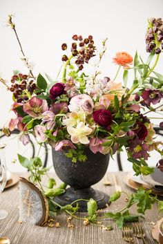 Honey of a Thousand Flowers - Spring blooms centerpiece by Sarah Winward, photo by Barret Doran