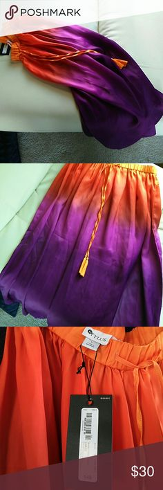 """Stylus L ombre maxi skirt For the woman who loves color!  This is a beautiful silky skirt that starts at the top with orange and transitions into a rich vibrant purple.  100% polyester.  33"""" elastic waist that stretches to 44"""".  36.5 inches long.  White inside.  Drawstring detail at front is for decoration only.  It does not run through waistband. Stylus Skirts Maxi"""