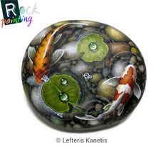 Koi fish on a pond! I made a special order painting on rock for Cheryl which i enjoy it very much! Acrylics on 11 cm rock.