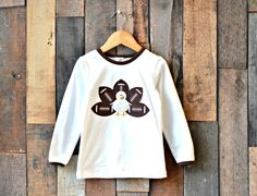 Up to 71% off retail! Football and Thanksgiving go hand in hand! Celebrate your love for both with our adorable Football Turkey Collection...items for girls and boys! This listing is for our Football Turkey Shirt, featuring a coolfootball turkey applique with plenty of room for a monogram if desired. Great for girls and boys! Available Sizes (we recommend youorder up if closer to the end of a size):  0-6 months 6-12 months 12-18 months 2T 3T 4T 5 6 7/8 10/12 Best Price Alert: When…