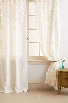 Over closet Love these! These are easy to create your own!! Buy sheers and hot glue the petals on! Fallen Petals Curtain #anthropologie