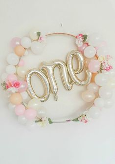 First birthday tea party for our baby girl, Scottie Rose! Florals, neutrals and pink party decor with a balloon garland arch and easy DIY ideas.