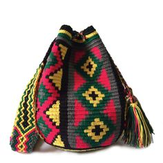 $49.90-$52.90 #Wayuubags. These double thread small mochila bag are perfect for carrying around a few items such as your phone, wallet and a few other necessities. They also make a very cute gift for younger women and young girls. The colors of these mochilas Wayuu are inspired by the vivid colors that surround region of La Guajira. All Wayuu bags come with a handwritten postcard, and little gift. The time required to elaborate a Wayuu Mochila varies from 4-7 days.  www.lombiaandco.com Tapestry Bag, Tapestry Crochet, Gifts For Young Women, Phone Wallet, Little Gifts, Cute Gifts, Women Empowerment, Vivid Colors, Bucket Bag