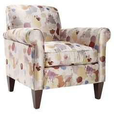 Add a pop of pattern to your living room or den with this lovely wood arm chair, showcasing a paint splatter motif and square tapered legs. Made in the USA. ...