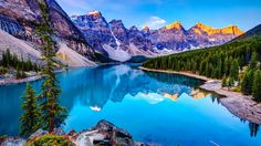 View of Moraine lake with colorful mountains at sunrise in Banff National park. Description from gettyimages.com. I searched for this on bing.com/images