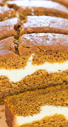 Cream Cheese-Filled Pumpkin Bread ~ The cream cheese layer that runs through the bread is like having a layer of cheesecake baked into pumpkin bread. It really makes the bread out of this world good.