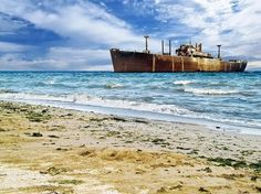 The shipwreck MV E. Evangelia, aground at Costinesti on the Black Sea coast of Romania since Ship Breaking, Soviet Navy, Water Background, Belize City, Abandoned Ships, Fraser Island, Tug Boats, Shipwreck, Great Lakes