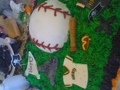 my new I created at Holly Berry's Cakery.....vanilla birthday cake flavor sheet cake.  with half cookies and cream filling and half raspberry filling with vanilla buttercream frosting.  baseball is cake covered in fondant