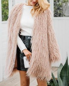 Long faux fur shaggy jacket Material: Faux Fur Clothing Length: Long Collar: V-Neck Closure Type: Covered Button Type: Wide-waisted